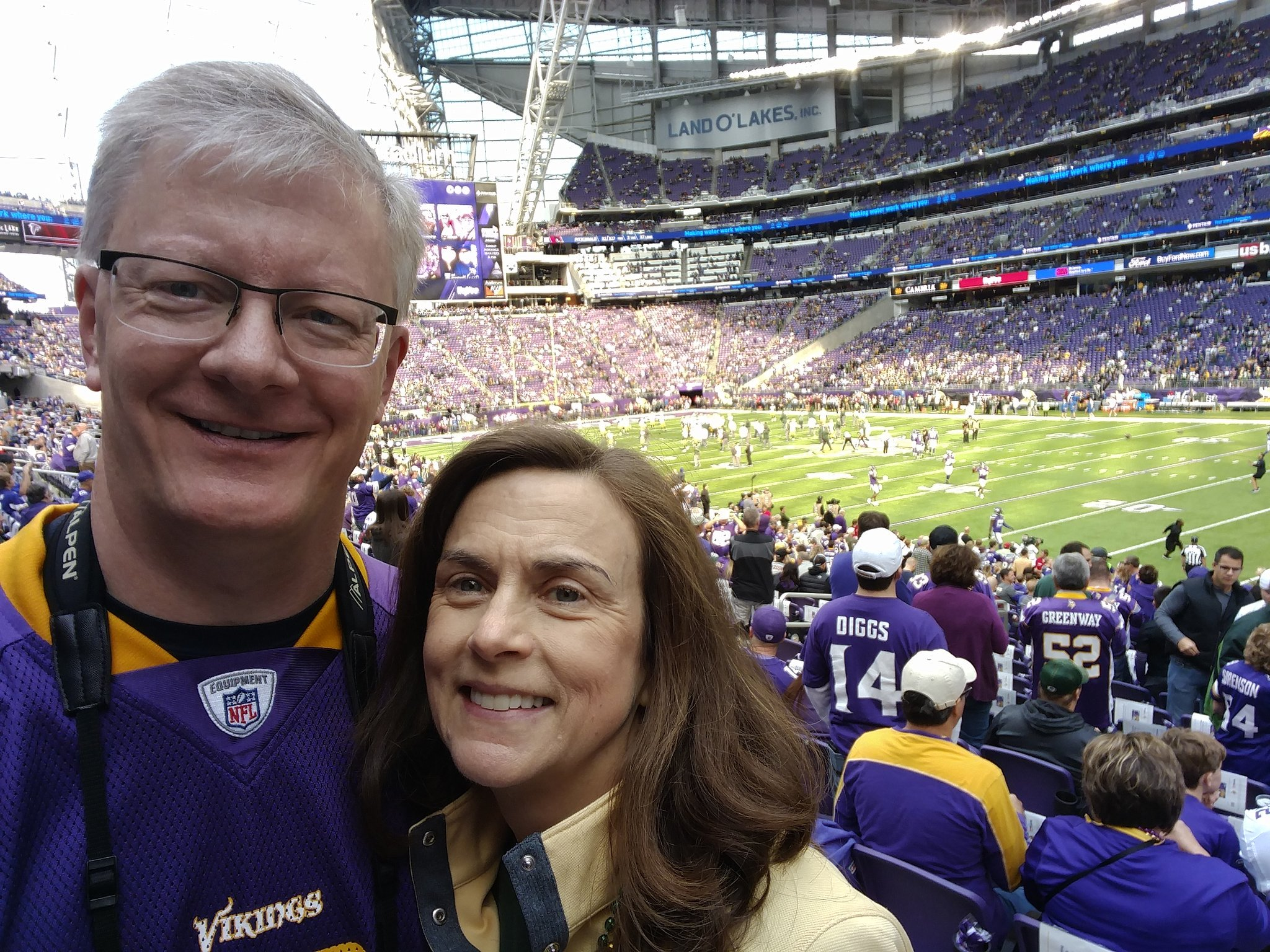 Kevin and his wife at a football game